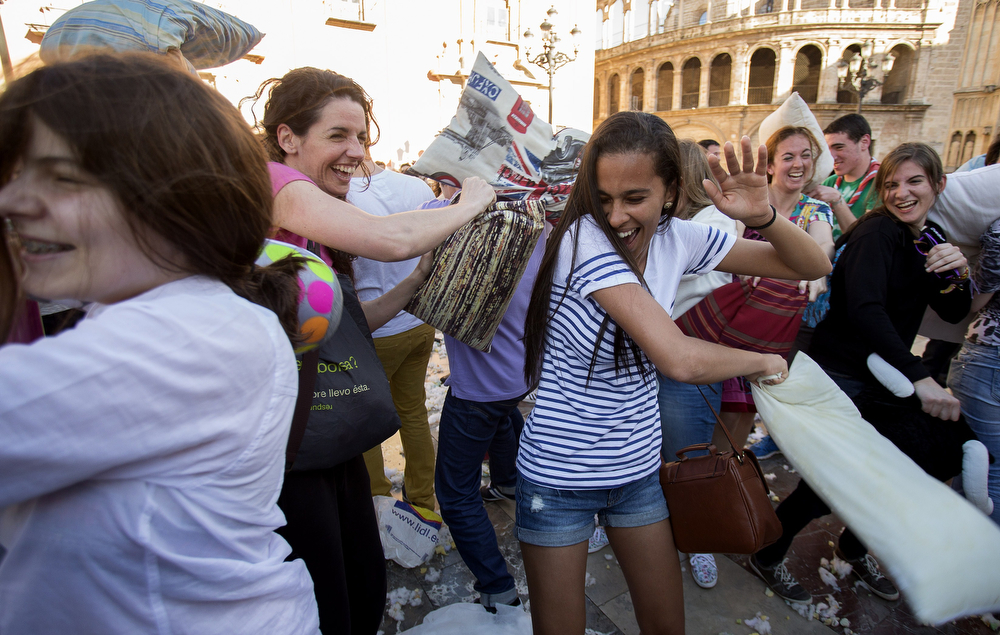 . People hit each other with pillows during an event dubbed International Pillow Fight Day in Valencia on April 5, 2014. The event, which was created in 2008, claims worldwide participation of over 80 cities for the 2014 edition.  (JOSE JORDAN/AFP/Getty Images)
