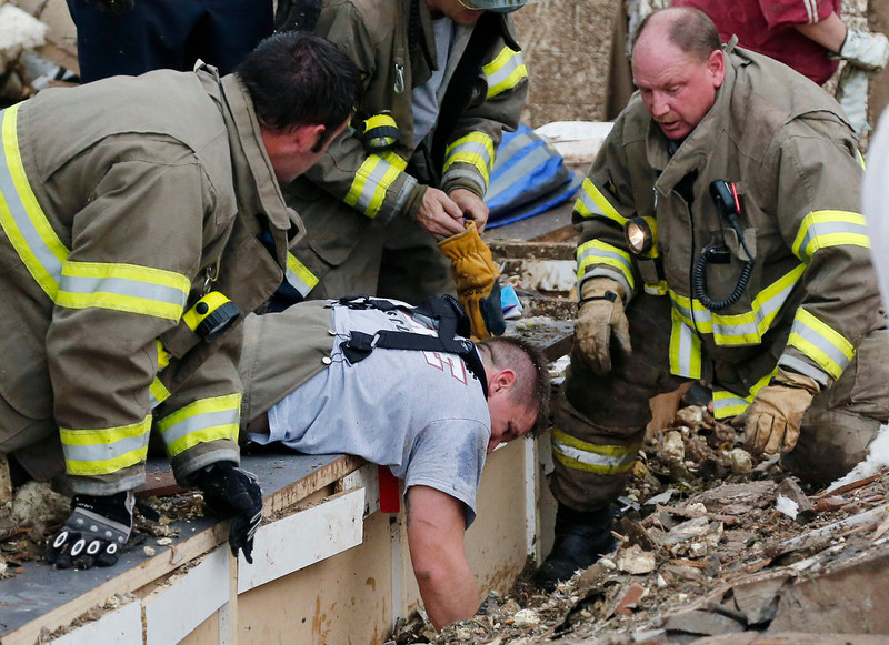 . Rescue workers dig through the rubble of a collapsed wall at the Plaza Tower Elementary School to free trapped students in Moore, Okla., following a tornado Monday, May 20, 2013. A tornado as much as a mile (1.6 kilometers) wide with winds up to 200 mph (320 kph) roared through the Oklahoma City suburbs Monday, flattening entire neighborhoods, setting buildings on fire and landing a direct blow on an elementary school. (AP Photo Sue Ogrocki)