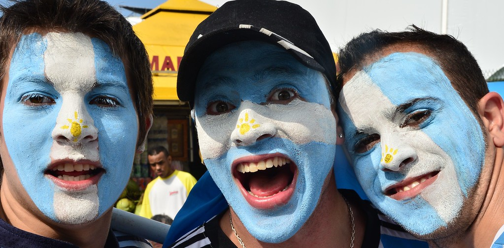 . Argentine fans pose at the FanFest at Copacabana beach in Rio de Janeiro as they gather to watch a live projection of the round of 16 football match between Argentina and Switzerland during the 2014 FIFA World Cup on July 1, 2014. AFP PHOTO / GIUSEPPE CACACE/AFP/Getty Images
