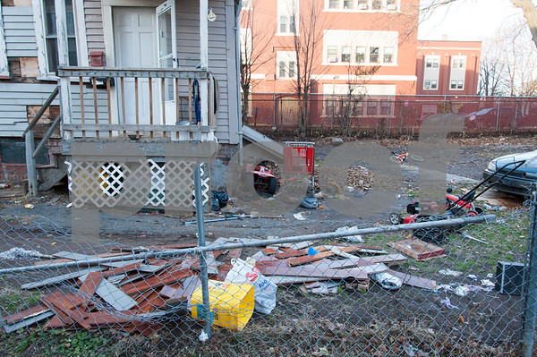 12/06/17 Wesley Bunnell   Staff Trash and other items on the side of 29 Tremont St in the North Oak Section of New Britain. Residents of the neighborhood have recently been speaking up regarding blight and alleged neglect from the city regarding their concerns.
