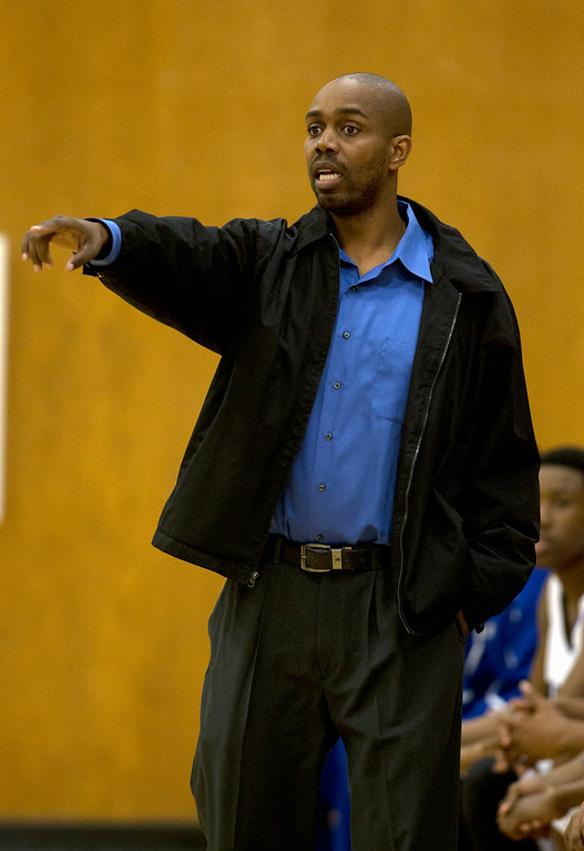 . Oakland High School coach Orlando Watkins directs his players during the first quarter of their Oakland Athletic League semi-final tournament game against Oakland Tech, Tuesday, Feb. 26, 2013 in Oakland, Calif. Oakland won, 70-58. (D. Ross Cameron/Staff)