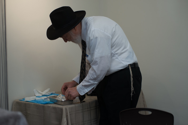 Rabbi Shmukler is preparing his instruments for his grandsons bris. He will be the moyle.