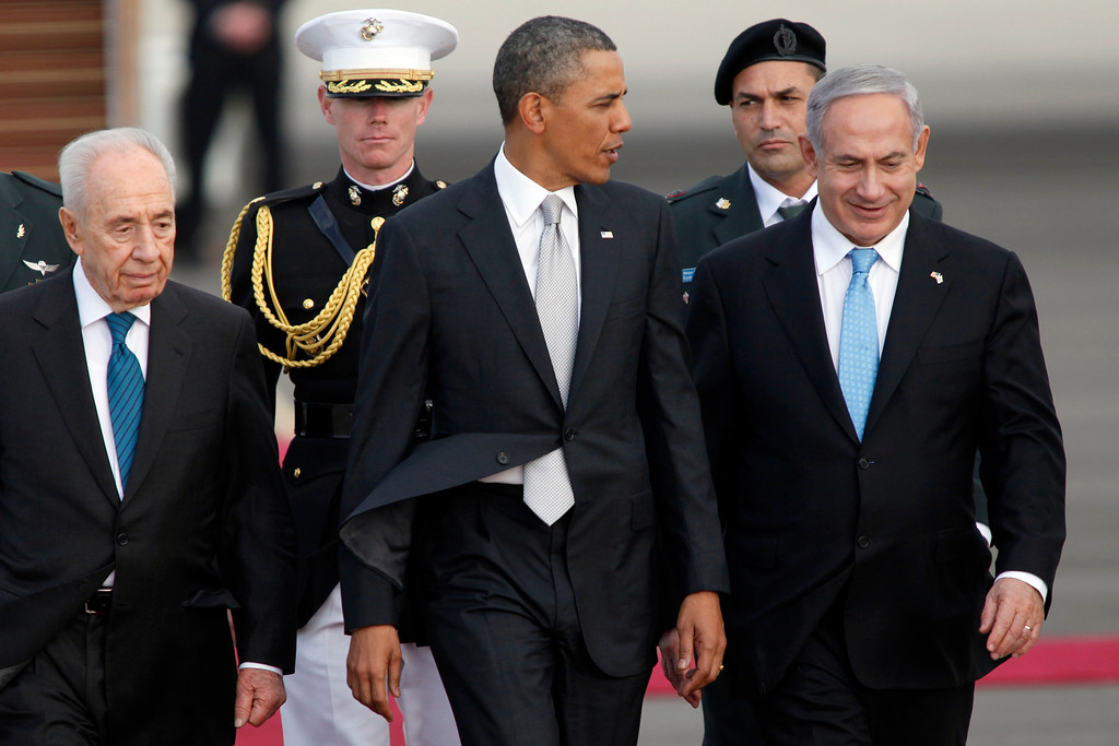 . Israeli President Shimon Peres, U.S. President Barack Obama, Israeli Prime Minister Benjamin Netanyahu walk together prior to Obama departing from Ben Gurion International Airport on March 22, 2013 in Lod\' Israel. Obama concluded his first visit to Israel and West Bank after three-days of meetings with Israeli and Palestinian leaders.  (Photo by Lior Mizrahi/Getty Images)