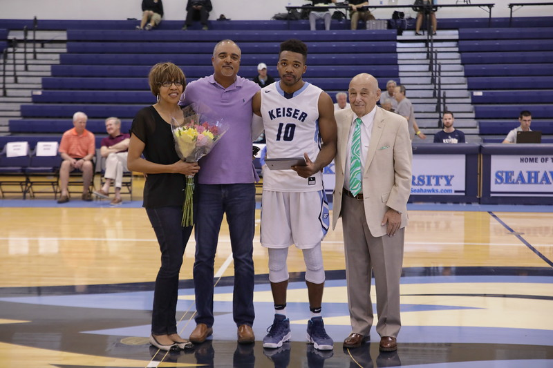 Keiser Senior Brice Jenkins with parents and Coach Massimino