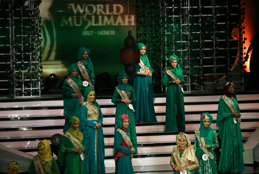 . Wednesday, Sept. 18, 2013 photo, contestants line up on the stage during the 3rd Annual Award of World Muslimah, a competition billed as the Islamic alternative to Miss World pageant, in Jakarta, Indonesia. Beauty queens and backstage drama may seem inevitable, but at this year\'s Miss World competition, something more serious than hair-pulling and name-calling has come from host country Indonesia: Muslim hardliners have threatened to hijack the competition despite major concessions from the government and organizers. (AP Photo/Dita Alangkara)