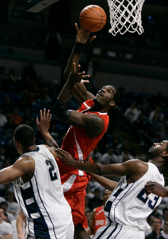 . Ohio State\'s Greg Oden, center, shoots over Penn State\'s Jamelle Cornley, left, and Brandon Hassell, right, during the first half of their college basketball game in  State College, Pa., Wednesday, Feb. 14, 2007.  (AP Photo/Carolyn Kaster)