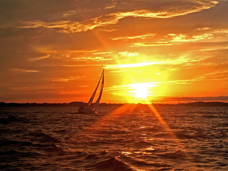 6/22 FBYC Moonlight Race - Mad Hatter sailing through the sunset.