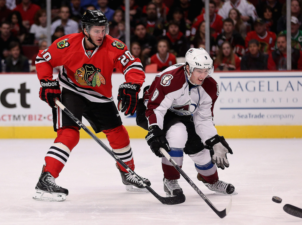 . Matt Duchene #9 of the Colorado Avalanche tries to catch the puck in front of Brandon Saad #20 of the Chicago Blackhawks at the United Center on March 6, 2013 in Chicago, Illinois.  (Photo by Jonathan Daniel/Getty Images)