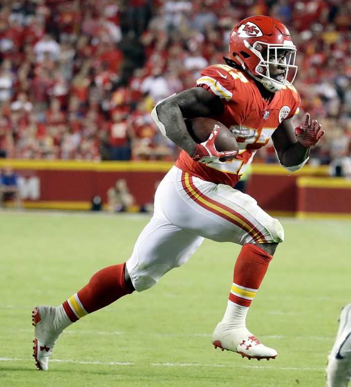 . Kansas City Chiefs running back Kareem Hunt (27) carries the ball during the second half of an NFL football game against the Washington Redskins in Kansas City, Mo., Monday, Oct. 2, 2017. (AP Photo/Charlie Riedel)