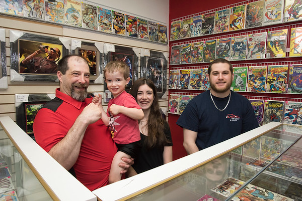 06/10/19 Wesley Bunnell | Staff Owner of IDeal Card & Memorabilia Alex Langlais holds his three year old son Xander as they stand next to daughter Cheyenne and Nick Mizzi inside of their location at 153 Main St in Terryville.