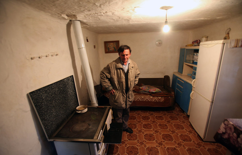 . Radoslav Stekic stands  in the room where his mother Danica was shot to death while sleeping in the village of Velika Ivanca, Serbia, Tuesday, April 9, 2013. A 60-year-old man gunned down 13 people, including a baby, in a house-to-house rampage in a quiet village on Tuesday before trying to kill himself and his wife, police and hospital officials said. Belgrade emergency hospital spokeswoman Nada Macura said the man, identified as Ljubisa Bogdanovic, used a handgun in the shooting spree at five houses. The dead included six women. (AP Photo/Darko Vojinovic)