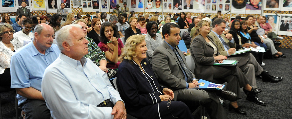 . Friends and families listen to speakers during a Los Angeles County Sheriff�s Department and Justice for Murdered Children unsolved homicide summit at the Los Angeles County Sheriff\'s headquarters on Saturday, July 20, 2013 in Monterey Park, Calif.  (Keith Birmingham/Pasadena Star-News)