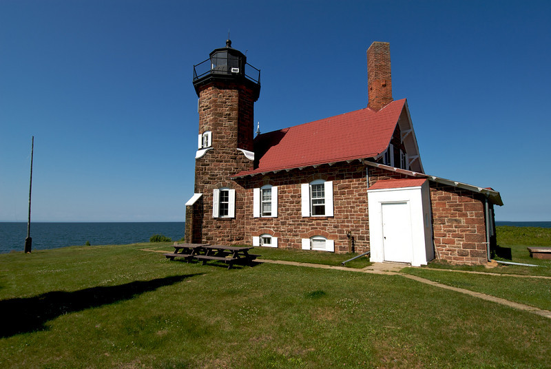 The light house again. Funny how we go out here to be in nature, but the thing that totally dominates my attention is the light house. Notice how the chimney sits diagonal to the roof line. Interesting.