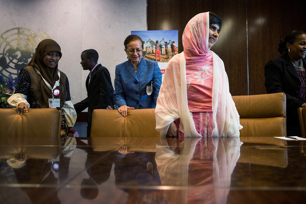 ". NEW YORK, NY - JULY 12:  Malala Yousafzai, the 16-year-old Pakistani advocate for girls education who was shot in the head by the Taliban, attends a conversation with the United Nations Secretary General Ban-ki Moon  Ban-ki Moon and other youth delegates at the United Nations Youth Assembly on July 12, 2013 in New York City. The United Nations declared July 12 ""Malala Day.\"" Yousafzai also celebrates her birthday today.  (Photo by Andrew Burton/Getty Images)"
