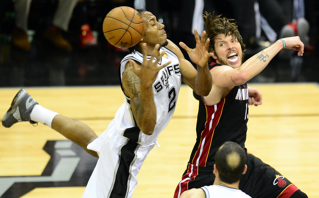 . Kawhi Leonard of the San Antonio Spurs vies for the ball with Mike Milelr of the Miami Heat during game 5 of the NBA finals on June 16, 2013 in San Antonio, Texas., where the Spurs defeated the Heat 114-104 and now lead the series 3-2.     FREDERIC J. BROWN/AFP/Getty Images
