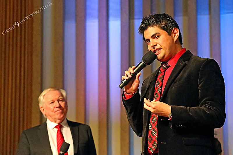AMER-CMM 00020 Max Mace, founder and directdor of Heritage Singers, watches new singer Miguel Verazas during a church performance by Peter J Mancus.JPG