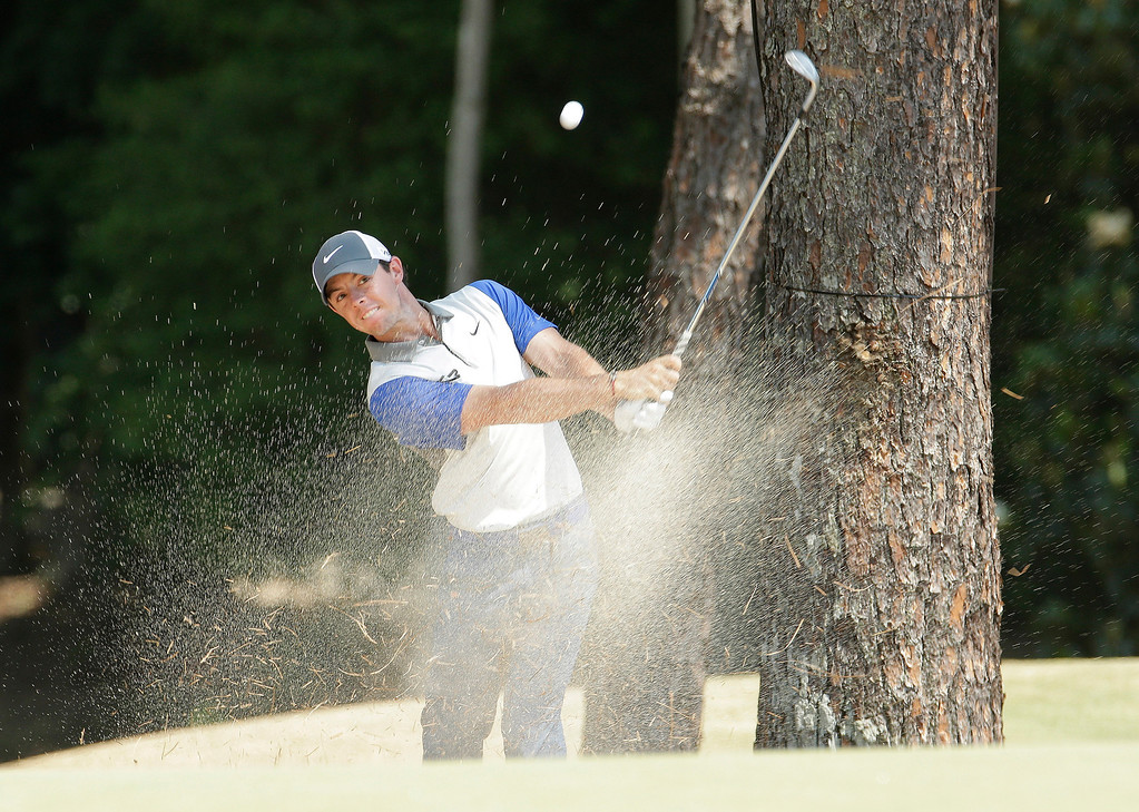 . Rory McIlroy, of Northern Ireland, hits from the natural area on the fifth hole during the final round of the U.S. Open golf tournament in Pinehurst, N.C., Sunday, June 15, 2014. (AP Photo/Charlie Riedel)
