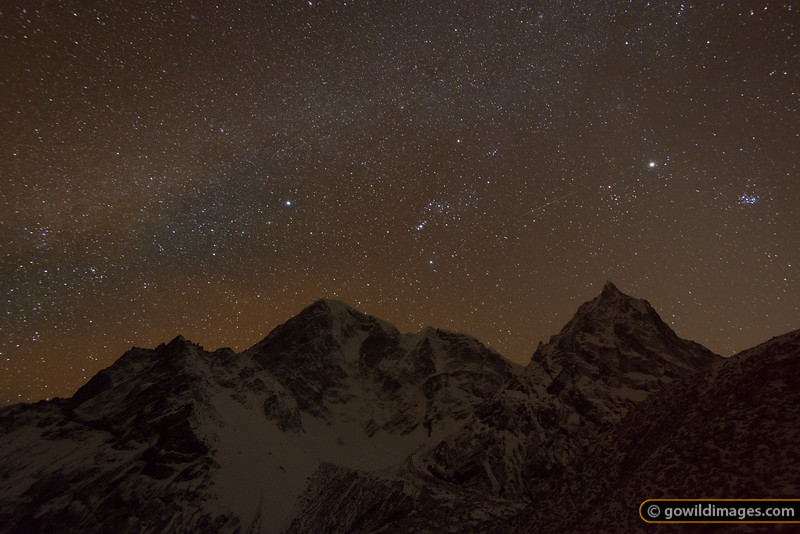6000m+ peaks hover over Dughla as a meteor flies under the Milky Way