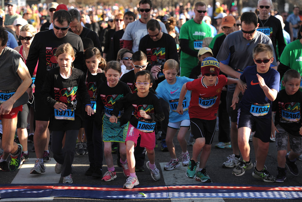 . Alleigh Macdonald, in pink shorts, takes off with other kids at the start of the kids 1.5K fun run.  The 31st annual Cherry Creek Sneak had all sorts of distances for this year\'s race.  The Sneak, as it is affectionately named, had a 10 mile, 5 mile, 3.1 mile or 5K, a 1.5 mile Denver\'s 7 Sprint, and a kid\'s fun run for thousands of competitors, runners and walkers that turned out in the Cherry Creek neighborhood of Denver, CO on April 28, 2013.  The race is always held the last Sunday in April. This year participants cheered the national anthem and observed a moment of silence for victims of the Boston Marathon bombing at the start of each race. (Photo by Helen H. Richardson/The Denver Post)