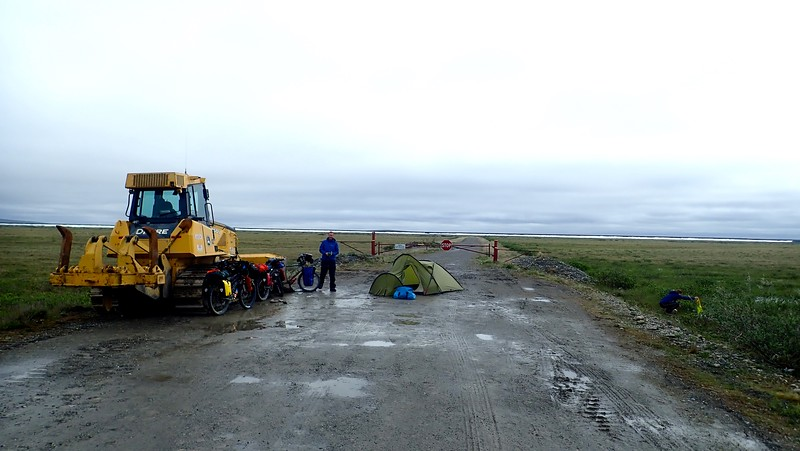 First camp in rain/sleet. While we cooked dinner, we spotted a grizzly 200m away... The tractor provided great shelter against the cold wind.
