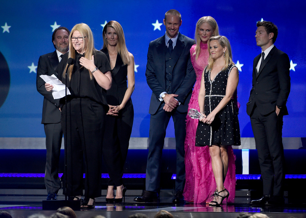 ". Bruna Papandrea, foreground left, and the cast and crew of ""Big Little Lies\"" accept the award for best limited series at the 23rd annual Critics\' Choice Awards at the Barker Hangar on Thursday, Jan. 11, 2018, in Santa Monica, Calif. (Photo by Chris Pizzello/Invision/AP)"