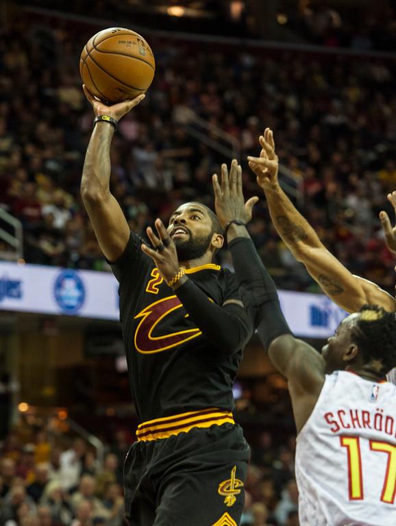 . Cleveland Cavaliers\' Kyrie Irving (2) drives to the basket as Atlanta Hawks\' Dennis Schroder (17) defends during the first half of an NBA basketball game in Cleveland, Tuesday, Nov. 8, 2016. (AP Photo/Phil Long)