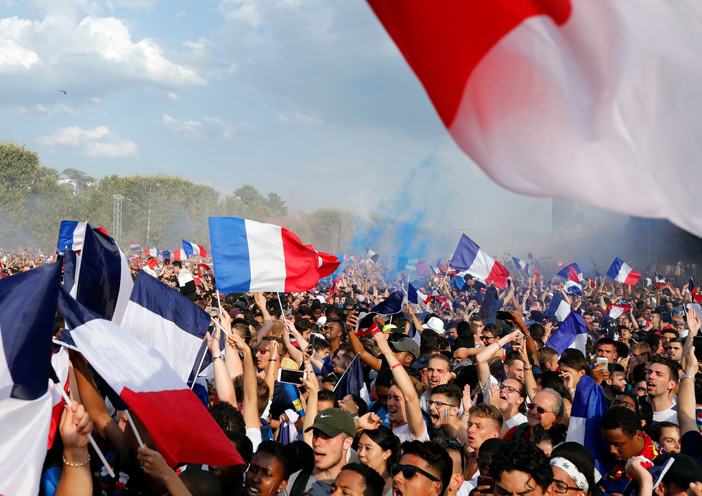 . French soccer team supporters celebrate after France won the World Cup final between France and Croatia, Sunday, July 15, 2018 in Paris. France won its second World Cup title by beating Croatia 4-2. (AP Photo/Laurent Cipriani)