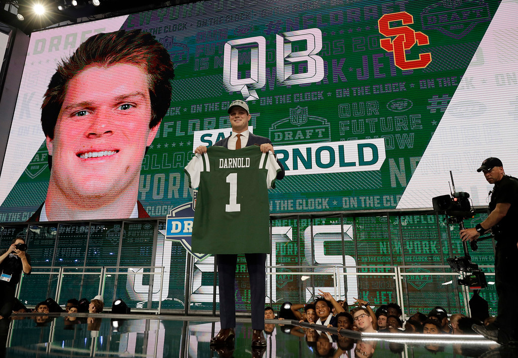 . USC\'s Sam Darnold poses on stage after being picked by the New York Jets during the first round of the NFL football draft, Thursday, April 26, 2018, in Arlington, Texas. (AP Photo/David J. Phillip)
