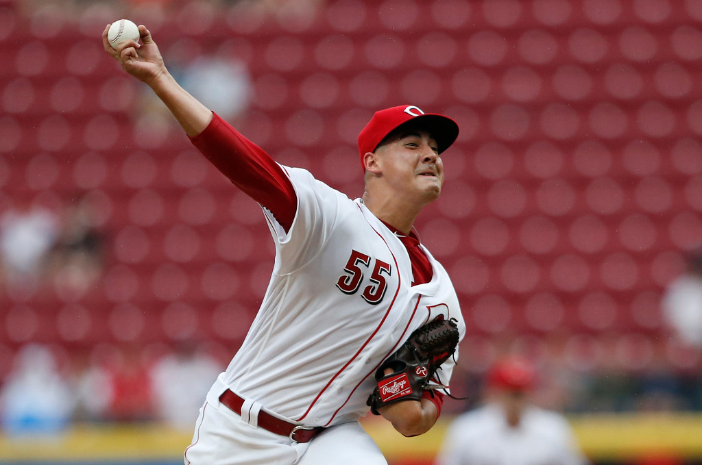 . Cincinnati Reds starting pitcher Robert Stephenson throws to a Cleveland Indians batter during the first inning of a baseball game, Wednesday, Aug. 15, 2018, in Cincinnati. (AP Photo/Gary Landers)