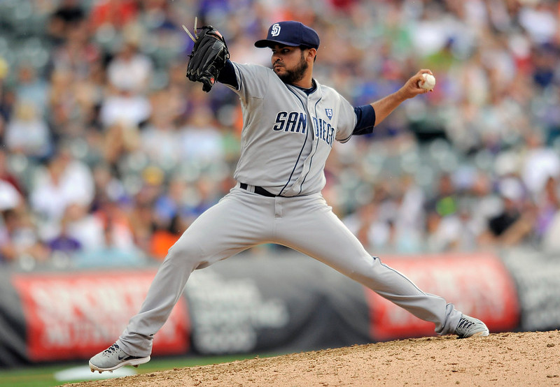 . San Diego Padres relief pitcher Alex Torres throws in the sixth inning of a baseball game against the Colorado Rockies, Sunday, Sept. 7, 2014, in Denver. The Rockies won 6-0. (AP Photo/Chris Schneider)