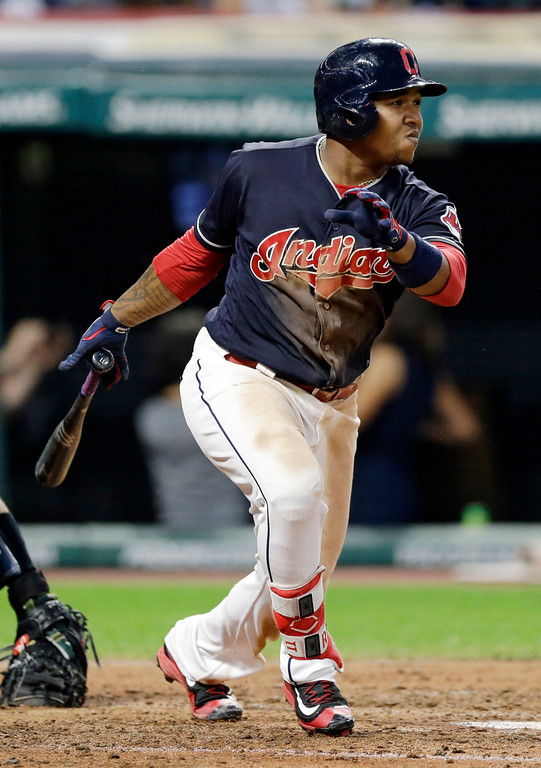 . Cleveland Indians\' Jose Ramirez hits an RBI single off San Diego Padres relief pitcher Kevin Quackenbush during the sixth inning of a baseball game, Thursday, July 6, 2017, in Cleveland. (AP Photo/Tony Dejak)