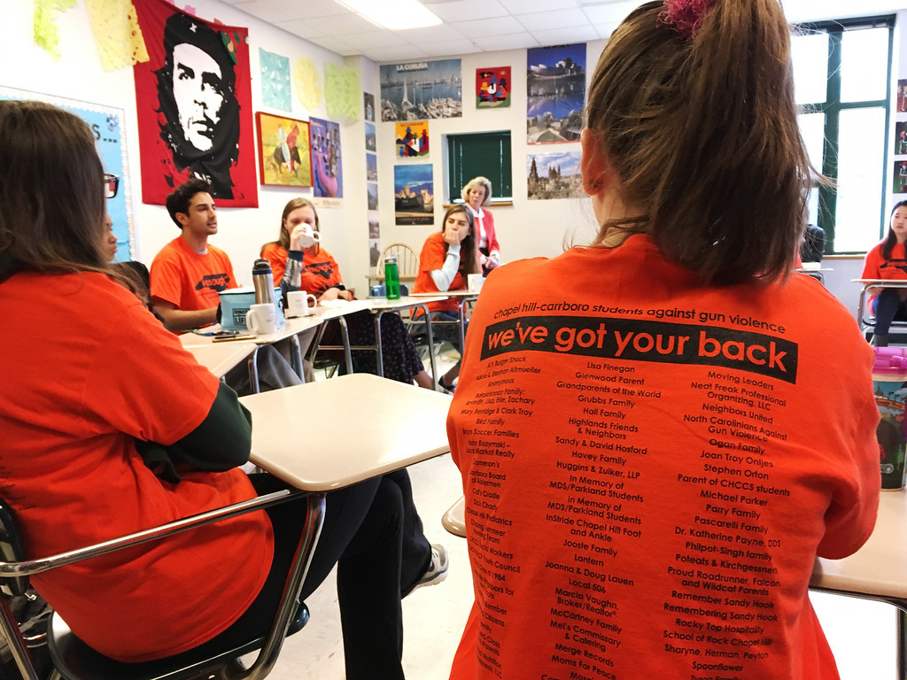 . Students discuss gun violence ahead of a walkout at East Chapel Hill High School on Wednesday, March 14, 2018, in Chapel Hill, N.C. (AP Photo/Jonathan Drew)
