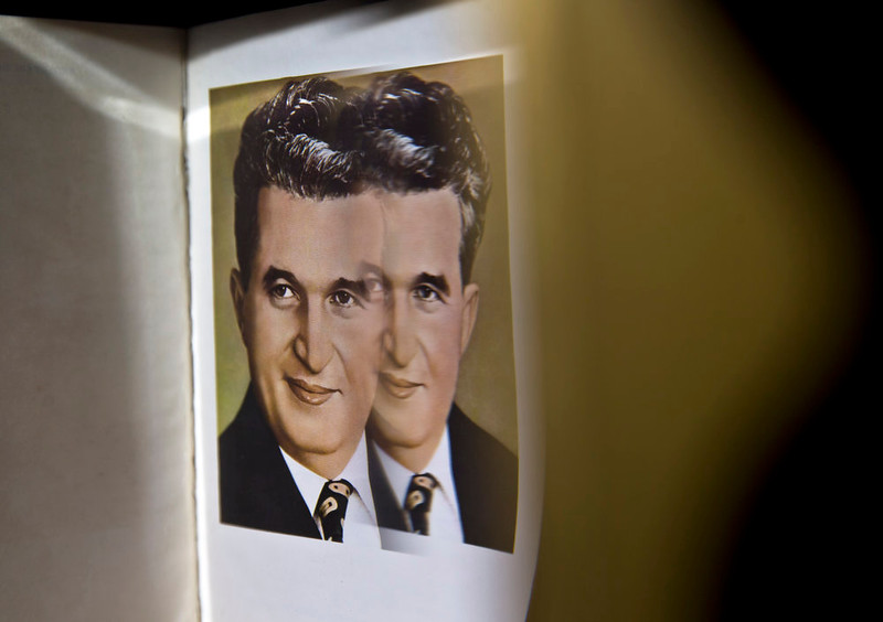 . A picture taken on Dec. 15, 2014 shows a book carrying the portrait of Romanian communist dictator Nicolae Ceausescu at the military garrison, turned museum, in Targoviste, Romania, where he and his wife Elena were executed on Dec. 25, 1989.  (AP Photo/Vadim Ghirda)