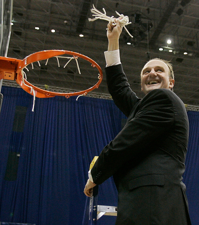 . Ohio State coach Thad Matta cuts down the net following a 92-76 win over Memphis in the  NCAA South Regional final basketball game at the Alamodome in San Antonio Saturday, March 24, 2007.  (AP Photo)