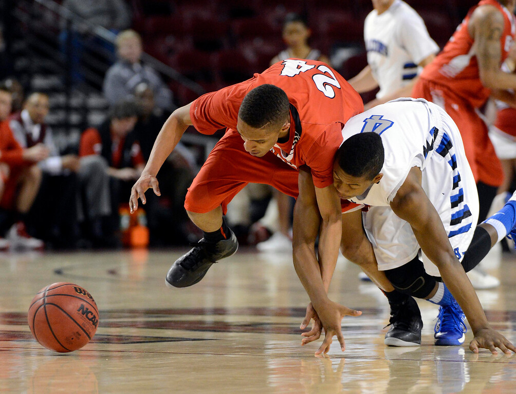 . DENVER, CO. - FEBRUARY 09: Dominique Collier (24) of East scrambles for a loose ball with Jalen Kittrell (4) of Highlands Ranch February 9, 2012 at Magness Arena.  East defeated Highlands Ranch 73 - 54. (Photo By John Leyba/The Denver Post)