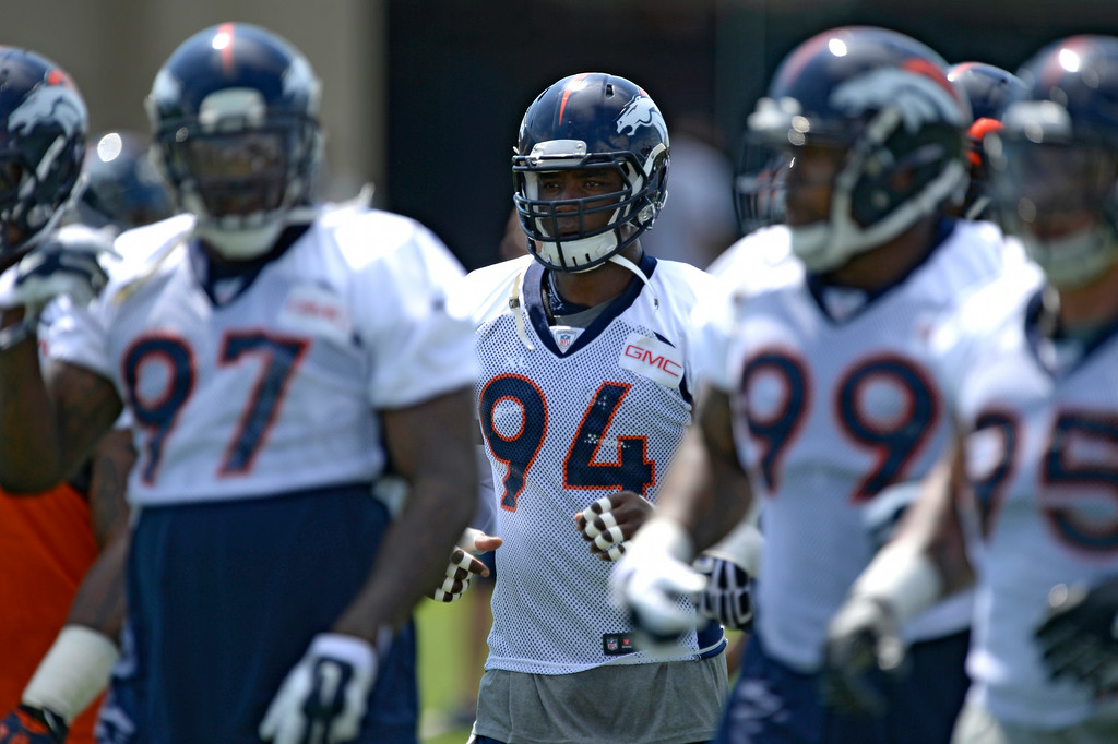 . Denver Broncos defensive end DeMarcus Ware (94) heads to drills  during day two of the Denver Broncos 2014 training camp July 25, 2014 at Dove Valley. (Photo by John Leyba/The Denver Post)