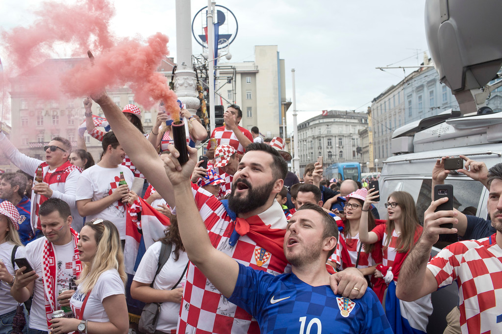 . Croatian soccer fans jubilate before the start of the World Cup final in central Zagreb, Croatia, Sunday, July 15, 2018. Croatia\'s national soccer team faces France in the World Cup final in Russia. (AP Photo/Marko Drobnjakovic)
