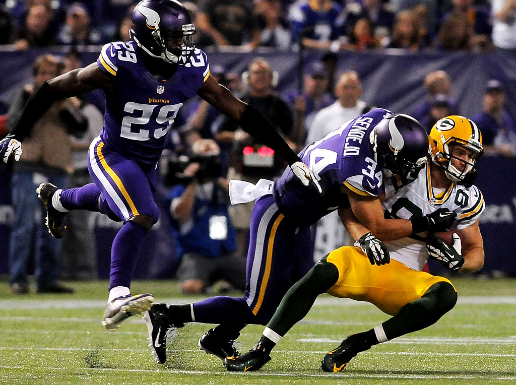 . Green Bay Packers wide receiver Jordy Nelson makes a catch as Minnesota Vikings\' strong safety Andrew Sendejo (34) and cornerback Xavier Rhodes (29) cover him during the third quarter. (Pioneer Press: Sherri LaRose-Chiglo)