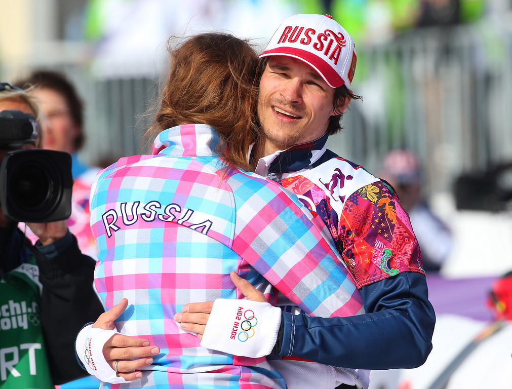 . SOCHI, RUSSIA - FEBRUARY 22:  Gold medalist Vic Wild of Russia celebrates celebrates with Alena Zavarzina of Russia after the Snowboard Men\'s Parallel Slalom Finals on day 15 of the 2014 Winter Olympics at Rosa Khutor Extreme Park on February 22, 2014 in Sochi, Russia.  (Photo by Mike Ehrmann/Getty Images)