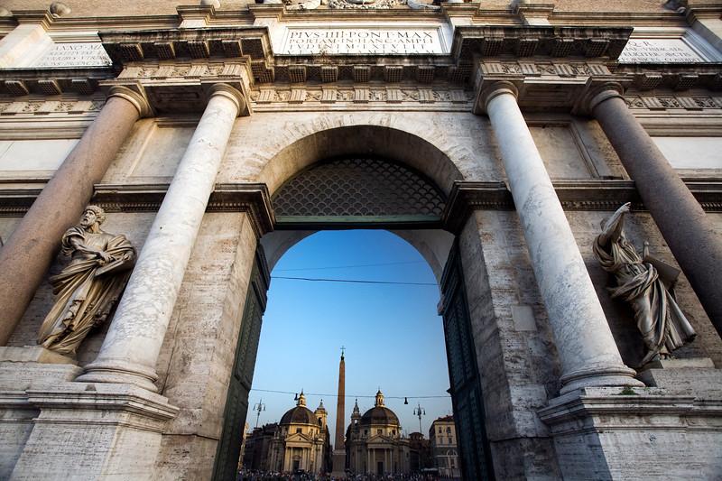 Outer facade of Porta del Popolo, Rome, with Piazza del Popolo on the background
