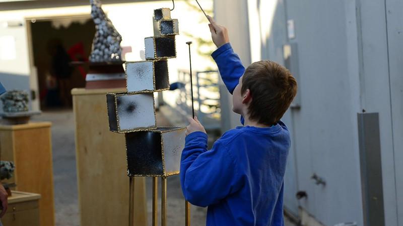 Wyatt playing a drum art piece at Open Studios December 3rd 2011.