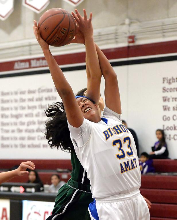 . Bishop Amat\'s Jurhandi Molina (33) rebounds against Bonita in the first half of the Covina basketball tournament at Covina High School in Covina, Calif., on Saturday, Dec. 14, 2013. Bonita won 49-41.   (Keith Birmingham Pasadena Star-News)