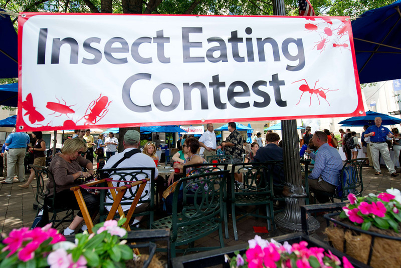 . Patrons sit and eat various edible insects June 4, 2014 during a global Pestaurant event sponsored by Ehrlich Pest Control, held at the Occidental Restaurant in Washington, DC. For one day only, pop-up Pestaurants will appear in cities across the globe to offer sweet and savory edible insects, grasshopper burgers and much more. Ehrlich Pest Control will be donating $5 USD to DC Central Kitchen for every person who eats something at the event.  (KAREN BLEIER/AFP/Getty Images)
