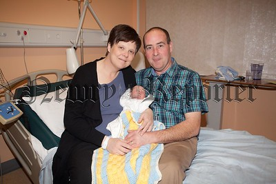 James and Patricia McDowell from Annalong are pictured with Baby Shea Patrick McDowell who was born on Christmas Day weighing 7lb 10oz. R1601006