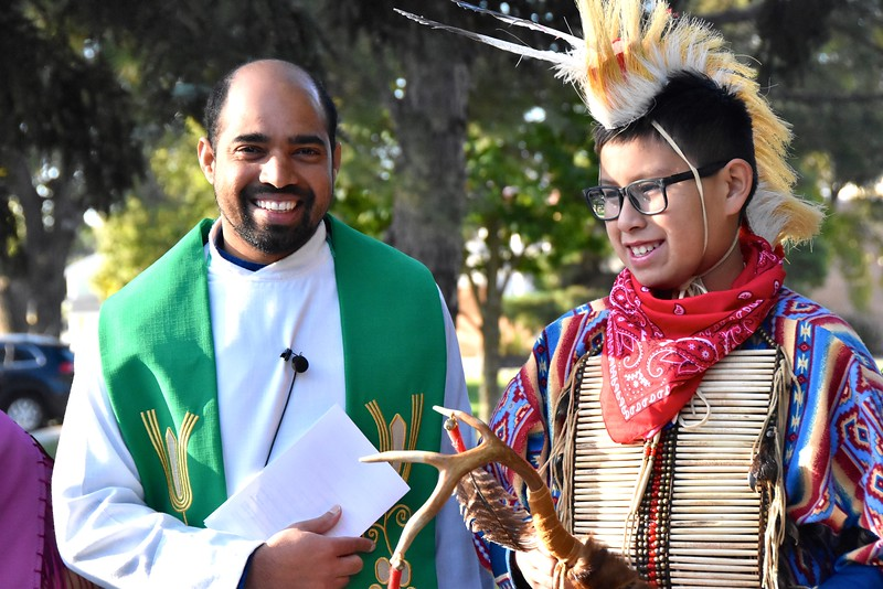 Fr. Praveen Richard with one of the student dancers prior to the Opening Mass