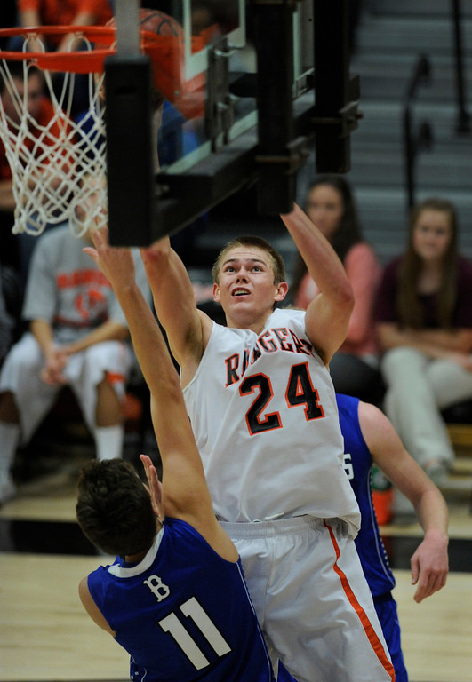. Rangers forward Justin Smith (24) worked the baseline for two in the fourth quarter. The Lewis-Palmer High School boy\'s basketball team defeated Broomfield 75-53 Friday night, December 7, 2012.  Karl Gehring/The Denver Post