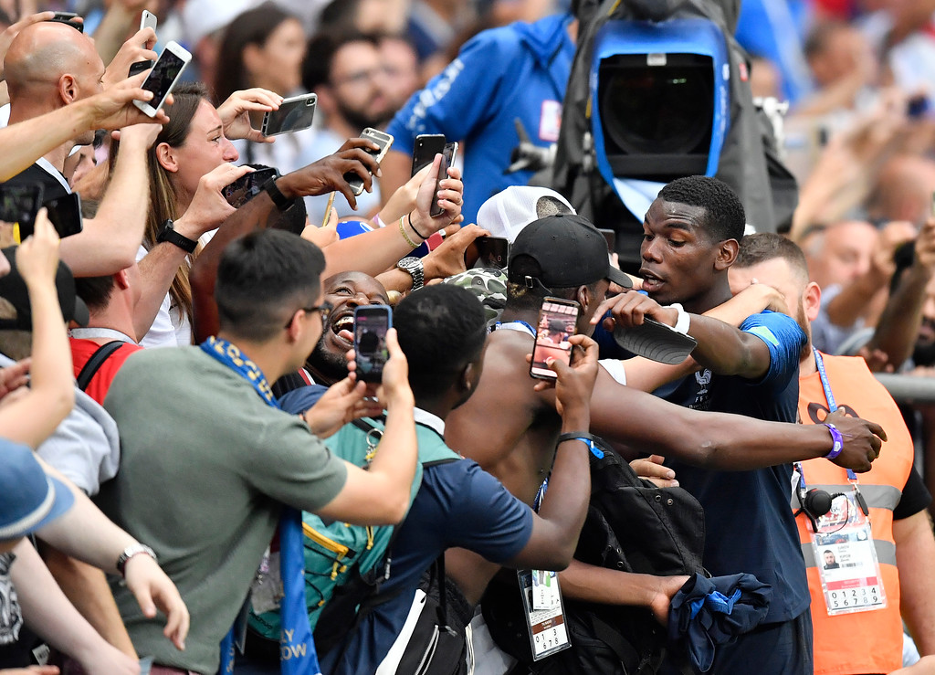 . France\'s Paul Pogba celebrates with fans after winning 4-2 during the final match between France and Croatia at the 2018 soccer World Cup in the Luzhniki Stadium in Moscow, Russia, Sunday, July 15, 2018. (AP Photo/Martin Meissner)