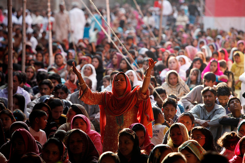. A Pakistani Christian woman raises her hands as she attends a Good Friday service at Saint Anthony Church in Lahore March 29, 2013. Holy Week is celebrated in many Christian traditions during the week before Easter. REUTERS/Mohsin Raza