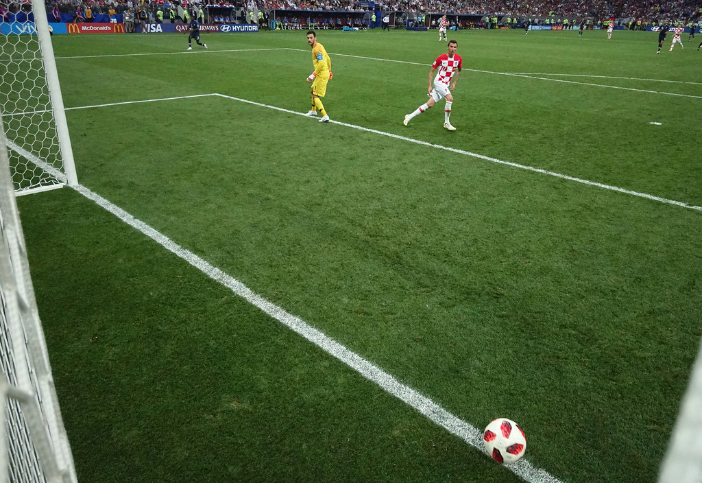 . France goalkeeper Hugo Lloris, left, looks round as Croatia\'s Mario Mandzukic scores his side\'s second goal during the final match between France and Croatia at the 2018 soccer World Cup in the Luzhniki Stadium in Moscow, Russia, Sunday, July 15, 2018. (AP Photo/Pavel Kopczynski, Pool via AP)