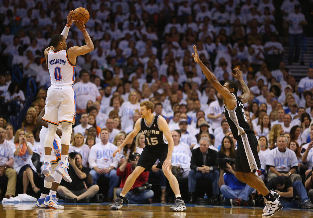 . OKLAHOMA CITY, OK - MAY 31:  Russell Westbrook #0 of the Oklahoma City Thunder shoots the ball against Kawhi Leonard #2 of the San Antonio Spurs in the first half during Game Six of the Western Conference Finals of the 2014 NBA Playoffs at Chesapeake Energy Arena on May 31, 2014 in Oklahoma City, Oklahoma. (Photo by Ronald Martinez/Getty Images)